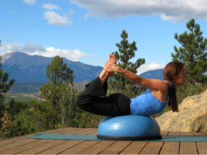 Yoga Bow Pose on the Bosu Balance Trainer.