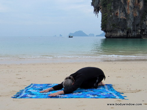 Traditional Child's Pose on Pranang Beach, Railay, Thailand