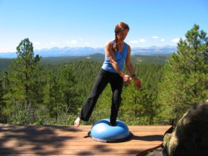Bosu Balance Trainer, standing on one leg with a twist to left.
