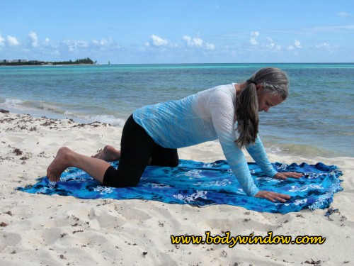 Beginning Frog Pose - Testing Your Body on a beach in Playa del Carmen, Mexico