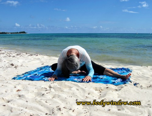 Half Dragonfly Pose on a beach in Playa del Carmen Mexico