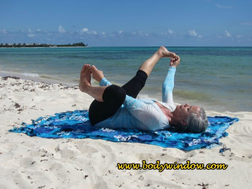 Happy Baby with Right Leg Extension, done on a beach in Playa del Carmen, Mexico.