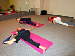 Lying Leg Crossover with Yoga Strap