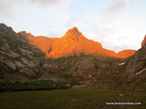 A beautiful shot of Pigeon Peak in the Alpenglow from high camp at 11,740 feet