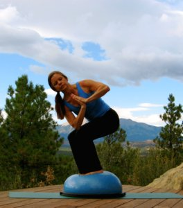 Yoga Revolved Fierce Pose with Prayer Hands on the Bosu Ball