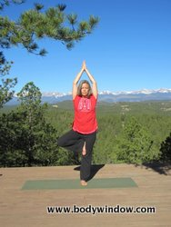 Tree Pose hands over head in prayer position