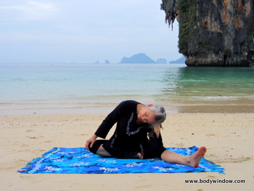 Yin Yoga's, Lateral Half Dragonfly Pose, Leaning to Side with Head in Hand, Pranang Beach, Railay, Thailand