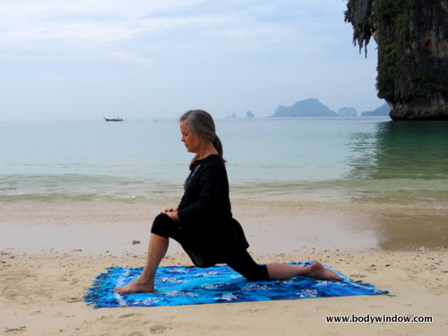 Photo of Elle Bieling doing Dragon Pose in Yin Yoga on Pranang Beach, Railay, Thailand
