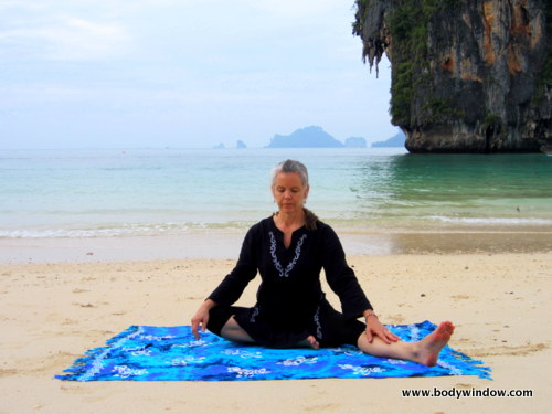 Photo of Elle Bieling doing Lateral Half-Dragonfly Pose, Pranang Beach, Railay, Thailand