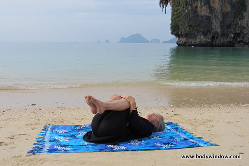 Yin Yoga's Knees Into Chest Pose, Pranang Beach, Railay, Thailand