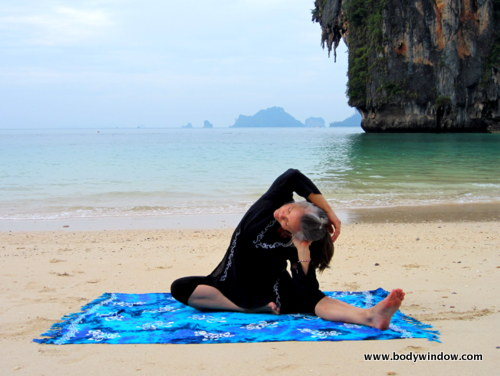 Yin Yoga's Lateral Half Dragonfly Pose, Arm Over Head, Pranang Beach, Railay, Thailand