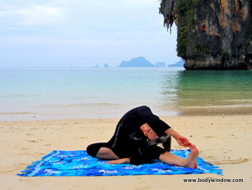 Yin Yoga's, Lateral Half Dragonfly Pose, Hand to Big Toe, Pranang Beach, Railay, Thailand