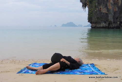 The Lying Spinal Twist in Yin Yoga, Pranang Beach, Railay, Thailand