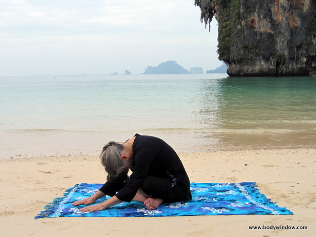 Photo of Elle Bieling doing Square Pose in Yin Yoga on Pranang Beach, Railay, Thailand