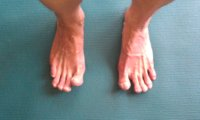 Curl up toes to check for grounding on foot tripod in Tadasana